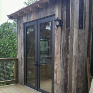 Sliding Front Door & Treehouse in Paradise | Tree Houses by Tree Top Builders